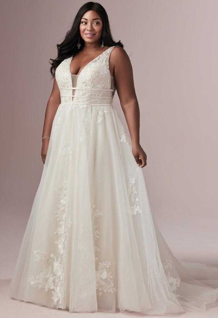 Kleid mit tiefem Ausschnitt und Applikationen